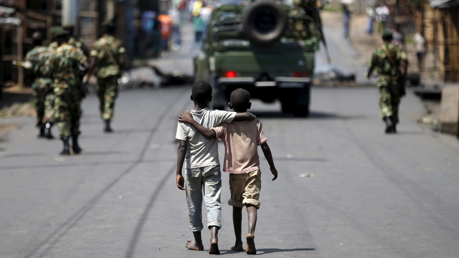 Boys behind patrolling soldiers, Burundi